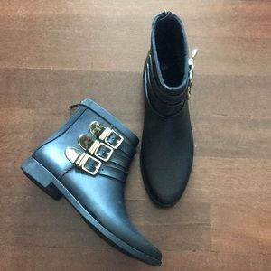 Black Rain boots with gold buckles